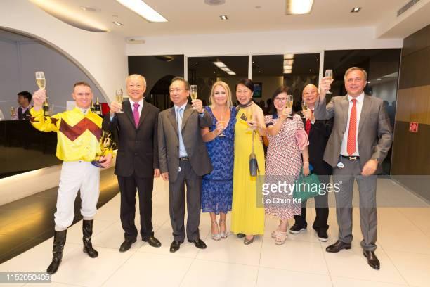 Jockey Zac Purton trainer Caspar Fownes and owner Boniface Ho Ka Kui celebrate after Hong Kong runner Southern Legend winning Race 9 Kranji Mile at...