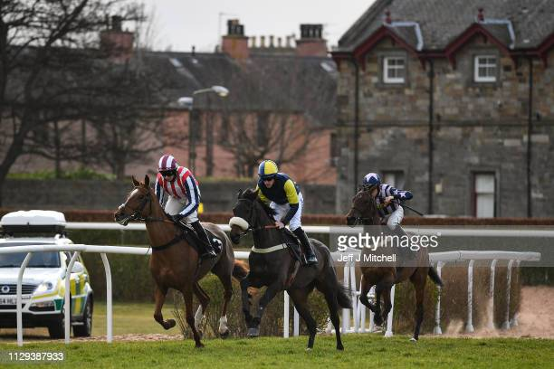 Jockeys and their horses at the start of the first race during the first fixture at Musselburgh racecourse following meetings being cancelled due to...
