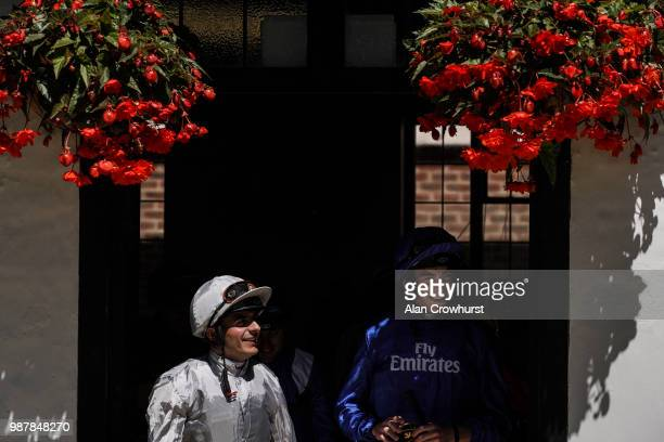 Jockeys Andrea Atzeni and James Doyle leave the weighing room at Newmarket Racecourse on June 30 2018 in Newmarket United Kingdom