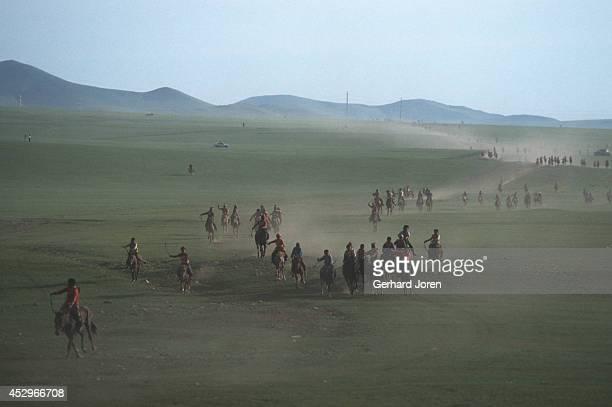 Jockeys as they near the finish line of a horse race