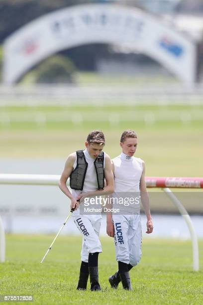 Jockeys Ben Allen and Mick Dee test the surface during Melbourne Racing at Sandown Lakeside on November 18 2017 in Melbourne Australia