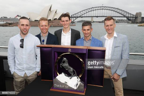 Jockeys Brenton Avdulla Kerrin McEvoy Regan Bayliss Corey Brown and Blake Shinn pose with the TAB Everest trophy during the TAB Everest Barrier Draw...