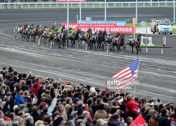 Jockeys compete during the 92nd Grand Prix d'Amerique, the most prestigious trotting race in Europe, on January 27, 2013 at the Vincennes racetrack,...