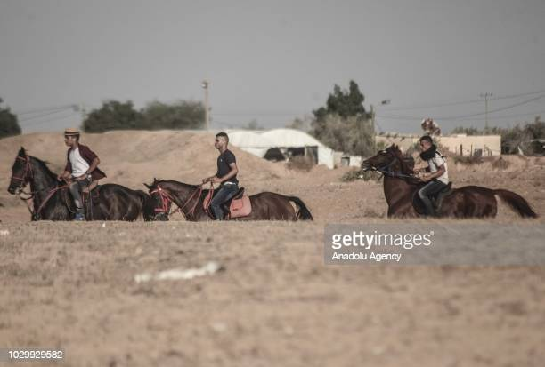 Jockeys compete in a horse race at the airfield of Yasser Arafat International Airport in Rafah Gaza on September 09 2018 Gaza International Airport...