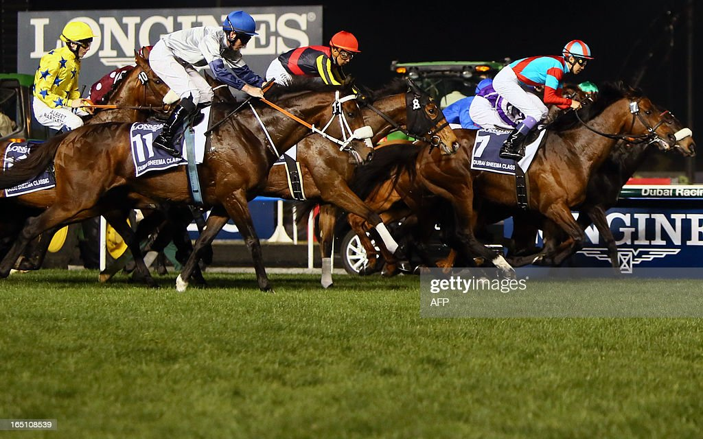 Jockeys compete in the Dubai Sheema Classic part of the Dubai World Cup meet, the world's richest race, at Meydan race track in Dubai on March 30, 2013.