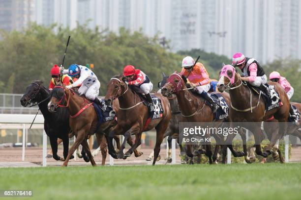 Jockeys compete in the Race 7 LONGINES Hong Kong Mile at Sha Tin Racecourse during the Hong Kong International Races Day on December 11 2016 in Hong...