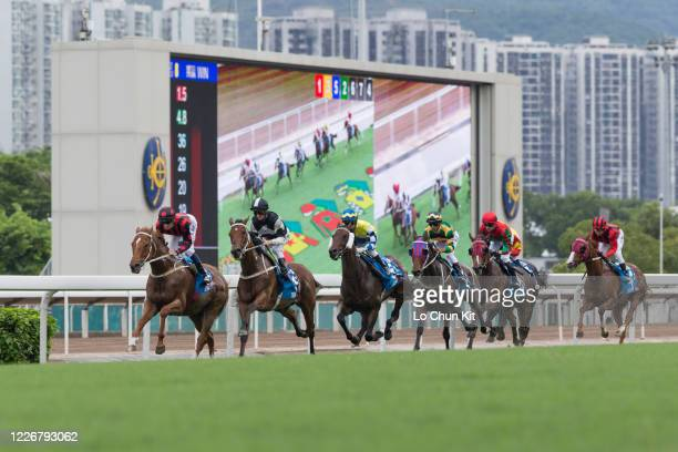 Jockeys compete in the Race 8 Standard Chartered Champions Chater Cup at Sha Tin Racecourse on May 24 2020 in Hong Kong