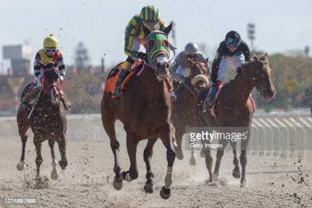 Jockeys compete in the second race won by horse Simple y Genial during competition day as Uruguay slowly returns to normal due to coronavirus...