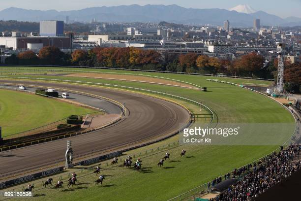 Jockeys compete the Race 1 at Tokyo Racecourse during the Japan Cup race day on November 26, 2017. Mount Fuji view beyond the 1st corner at Tokyo...