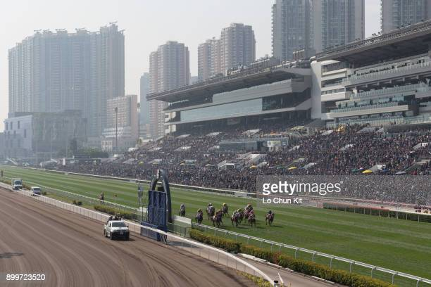 Jockeys compete the Race 2 Able Friend Handicap Huge crowds of fans at the Sha Tin Racecourse during the LONGINES Hong Kong International Races Day...