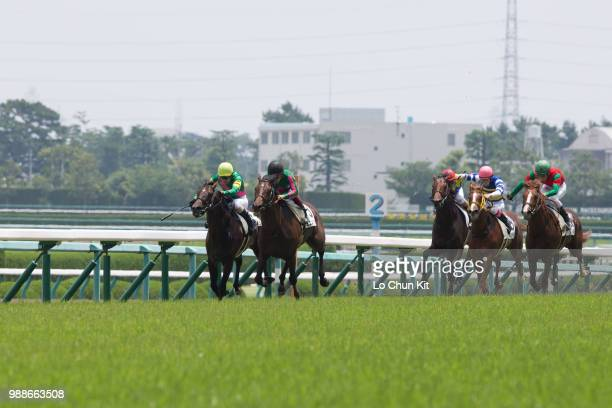 Jockeys compete the Race 4 at Hanshin Racecourse on June 24 2018 in Takarazuka Japan