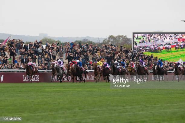 Jockeys compete the Race 4 Qatar Prix de l'Arc de Triomphe at ParisLongchamp racecourse on October 7, 2018 in Paris, France.