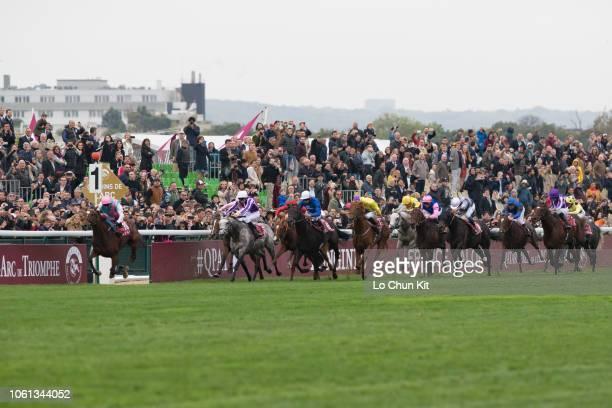 Jockeys compete the Race 4 Qatar Prix de l'Arc de Triomphe at ParisLongchamp racecourse on October 7 2018 in Paris France