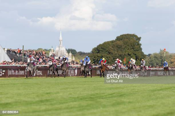 Jockeys compete the Race 5 Qatar Arabian World Cup during the Prix de l'Arc de Triomphe Race Day at Chantilly Racecourse on October 2 2016 in...