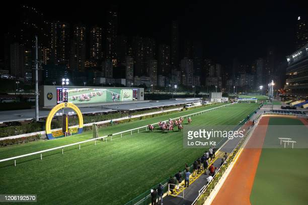February 12 : Jockeys compete the Race 6 Kwai Chung Handicap at Happy Valley Racecourse on February 12, 2020 in Hong Kong. The coronavirus lockout...