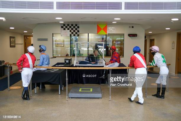 Jockeys gather in the weighing room before the first race at Ascot Racecourse on May 08, 2021 in Ascot, England. Only owners are allowed to attend...