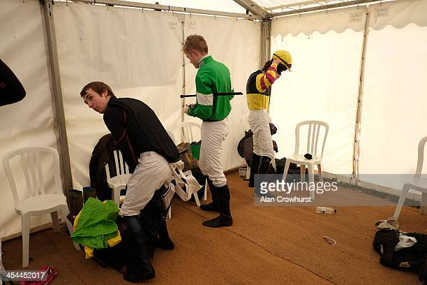 Jockeys get ready for their race during the point to point meeting at Barbury Castle racecourse on December 08 2013 in Swindon England