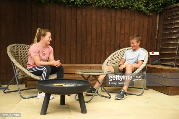 Jockeys Hollie Doyle and Tom Marquand look on on May 27 2020 in Hungerford England