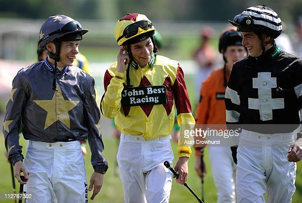 Jockeys Jamie Spencer Luke Morris and James Doyle share a joke as they walk to the parade ring at Folkestone racecourse on April 21 2011 in...