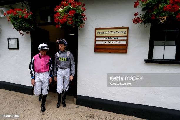 Jockeys jim Crowley and Fran Berry leave the weighing room at Newmarket Racecourse on June 29 2017 in Newmarket England