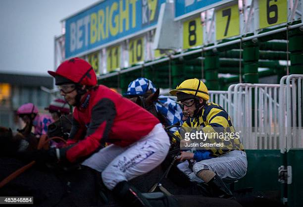 Jockeys jump off at the start ahead of Centrepoint Handicap at Lingfield Park on August 13 2015 in Lingfield England