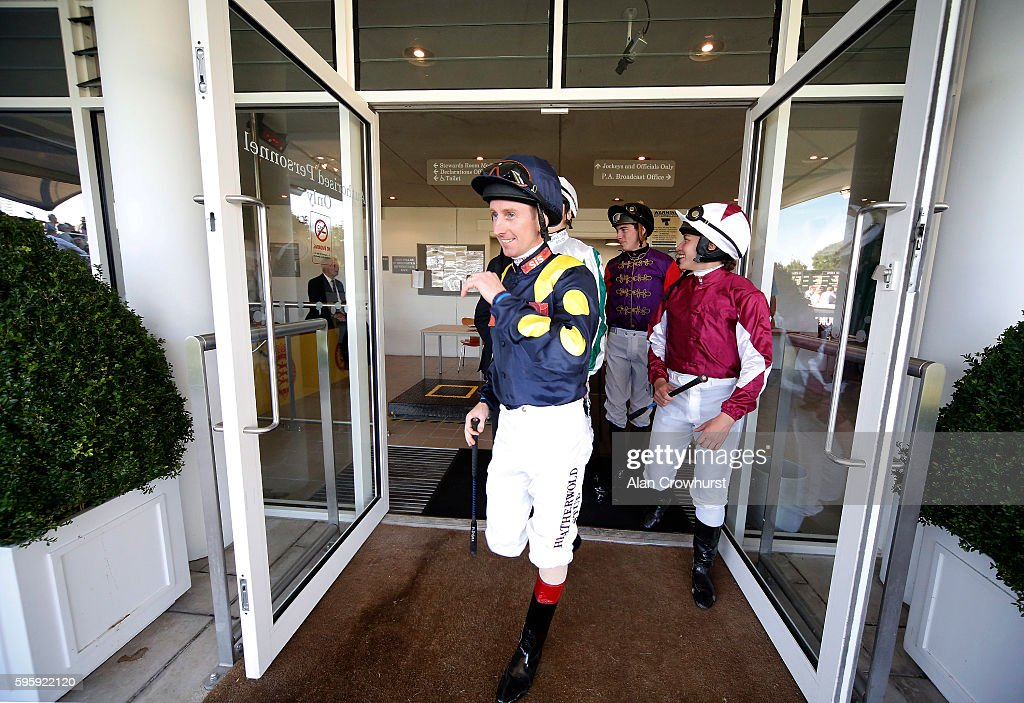 Jockeys leave the weighing rooms at Goodwood on August 26, 2016 in Chichester, England.