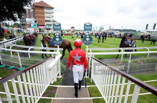 Jockeys make their way out for the Sky Bet And Symphony Group Handicap during day one of the Yorkshire Ebor Festival at York Racecourse on August 19,...