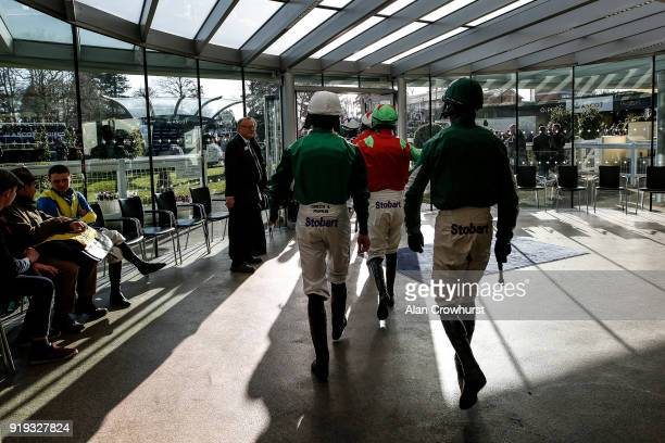Jockeys make their way to the parade ring at Ascot Racecourse on February 17 2018 in Ascot England