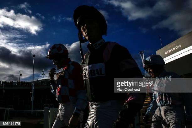 Jockeys make their way to the parade ring at Cheltenham racecourse on December 15 2017 in Cheltenham United Kingdom