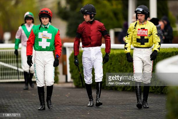 Jockeys make their way to the parade ring at Kempton Park on March 16 2019 in Sunbury England