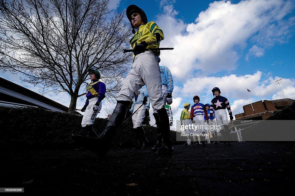 Jockeys make their way to the parade ring at Kempton racecourse on February 08, 2013 in Sunbury, England.
