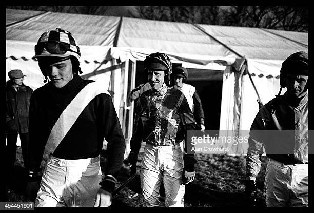 Jockeys make their way to the parade ring during the point to point meeting at Barbury Castle racecourse on December 08 2013 in Swindon England