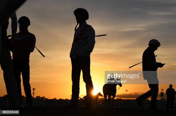 Jockeys Mark Zahra Brian Higgins and Damien Oliver are seen during jumpout sessions at Flemington Racecourse on March 10 2017 in Melbourne Australia