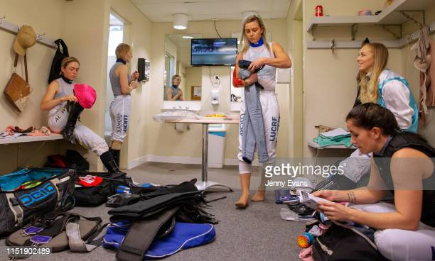 Jockeys Mikayla Weir Brooke Stower Wendy Peel Louise Day and Rhiannon Payne prepare for a race in the jockeys room during racing at Muswellbrook Race...