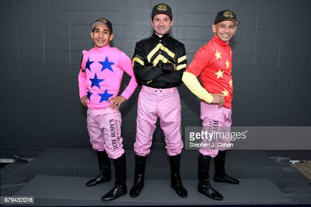 Jockeys Paco Lopez Kent DeSormeaux and Mike Smith pose prior to the 143rd running of The Kentucky Oaks at Churchill Downs on May 5 2017 in Louisville...