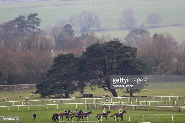 Jockeys parade at the start of the Rockwool Novices' Handicap Hurdle race at Chepstow Racecourse on March 23 2017 in Chepstow Wales