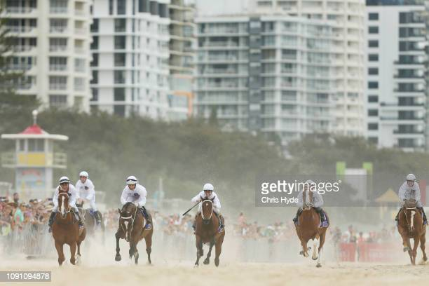 Jockeys race during the 2019 Magic Millions official barrier draw at Surfers Paradise Foreshore on January 08, 2019 in Gold Coast, Australia.