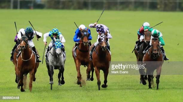 Jockeys raise their whips in race 8 during Sydney Racing at Rosehill Gardens on November 4, 2017 in Sydney, Australia.