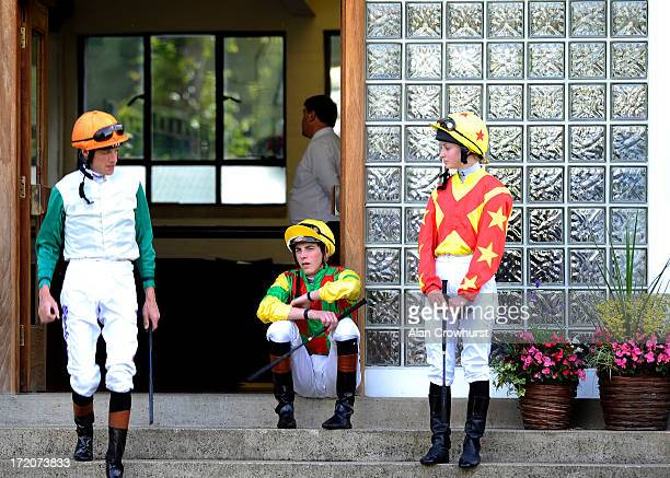 Jockeys Richard Hughes James Doyle and Danielle Mooney by the weighing room at Windsor racecourse on July 01 2013 in Windsor England