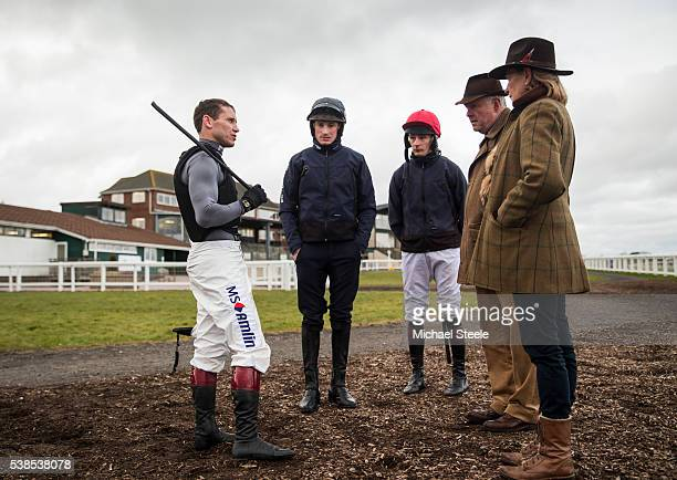 Jockeys Richard Johnson Tom O'Brien James Best in conversation with trainer Philip Hobbs and Sarah Hobbs after a pre Cheltenham work out at Exeter...