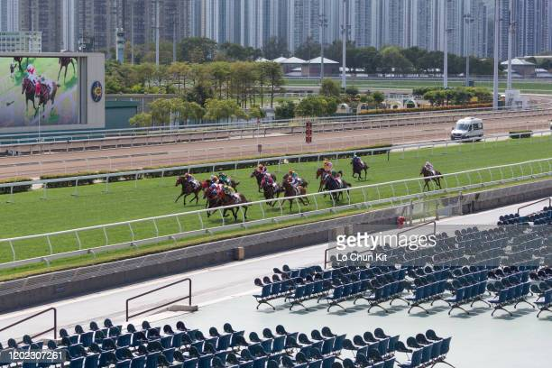 January 27 : Jockeys ride in front of empty seats during the Race 2 Kut Cheong Handicap during Chinese New Year Raceday 2020 at Sha Tin Racecourse on...