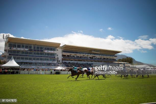 Jockeys ride their horse during a race held ahead of the Met horse race at Kenilworth race track on January 27 in Cape Town The Met is one of South...