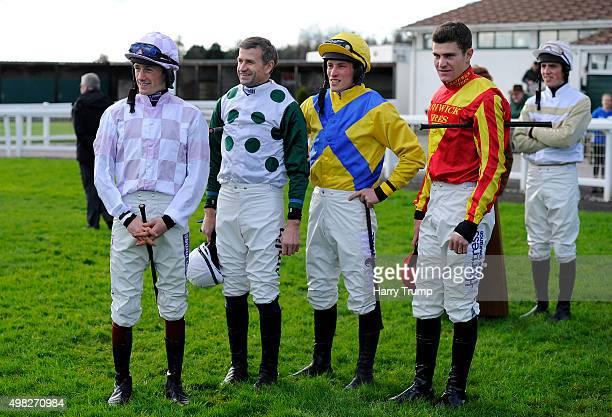 Jockeys Sam Twiston Davies Andrew Thornton Ian Popham and Nick Schofield chat at Exeter Racecourse on November 22 2015 in Exeter England