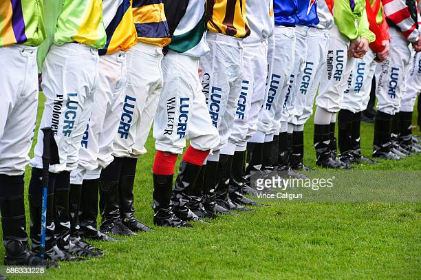 Jockeys stand during minute silence before the Jockey Celebration Day Handicap during Melbourne racing at Flemington Racecourse on August 6 2016 in...