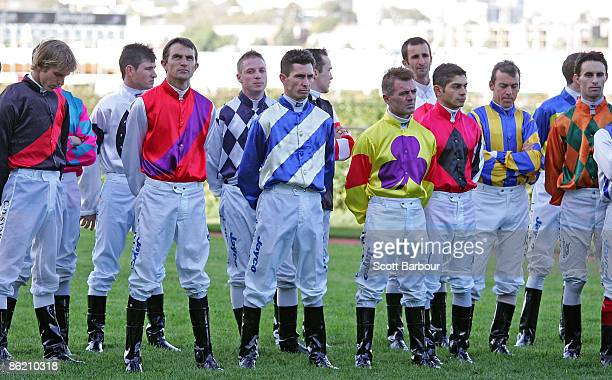 Jockeys stand for one minute's silence during the Anzac Day meeting at Flemington Racecourse on April 25 2009 in Melbourne Australia Today...