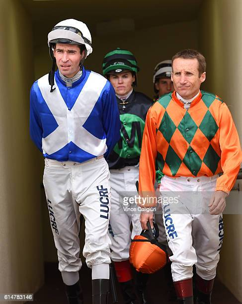 Jockeys Steven Arnold and Damien Oliver are seen during Caulfield Cup Day at Caulfield Racecourse on October 15 2016 in Melbourne Australia