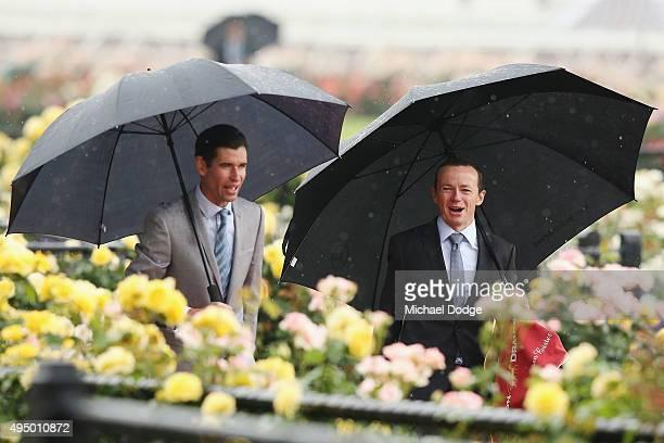 Jockeys Steven Arnold and Stephen Baster arrive on Derby Day at Flemington Racecourse on October 31 2015 in Melbourne Australia