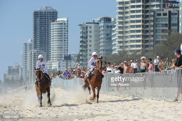 Jockeys, Timothy Bell and Hugh Bowman ride Play for Gold and Riding Honours during a Magic Millions photo call ahead of the Magic Millions official...