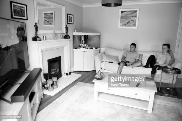 Jockeys Tom Marquand and Hollie Doyle look on from the sofa of their home on May 27 2020 in Hungerford England