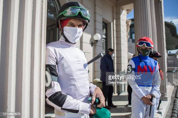 Jockeys wait for the race keeping the social distance during competition day as Uruguay slowly returns to normal due to coronavirus outbreak at...